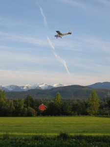 A Cessna on final approach offers a spectacular view of the Olympic Mountains as it passes over Sequim's Discovery Trail Farm airpark.