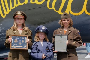 L to R: While touring the Collings Foundation's B-25, Kylie, Camille and Nicholas Koney honored their grandfather, former B-25 pilot Capt. William F. Koney, by wearing his uniforms.