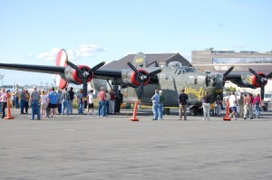 Long lines of visitors at Paine Field crowded around the display of a trio of WWII bombers, including this B-24 Liberator, a B-17 Flying Fortress and a B-25 Mitchell.
