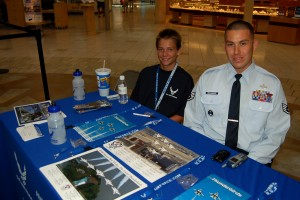Justin Brooks (left) helped Staff Sgt. Abel Bracamonte hand out pictures of the Thunderbirds and information on career opportunities in the Air Force.