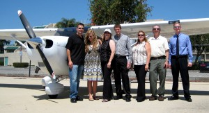 Several family members accompanied Lisa Kagarise to the Airtel to receive her prizes. L to R: Brian Terwilliger, Kagarise's daughter Cambria, Kagarise, son Brandon, Laura and Darin Smith, and Jim Pitman, Cessna Pilot Centers, who helped present the prize.