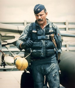 Robin Olds, commander of the 8th Tactical Fighter Wing in Southeast Asia, pre-flights his F-4C Phantom. Olds was credited for shooting down four enemy MiG aircraft in aerial combat over North Vietnam.