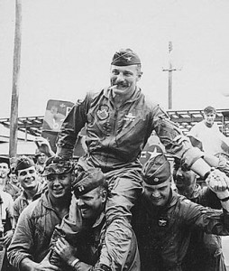 After his 100th combat mission over North Vietnam, his men carry Col. Robin Olds from his F-4 Phantom II.