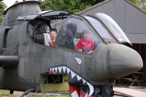 Cameron and Maura Holden experience the cockpit of a Cobra AH-1 gunship and pretend to be pilots for a day. The AH-1 was once the backbone of the Army's attack helicopter fleet, but has been replaced by the AH-64 Apache.