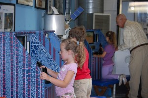 Children are drawn to the three flight simulators, which replicate the experience of flying.