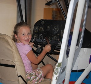 Little Cut Up is a composite mock-up made up of parts from airplanes such as the Piper Cub. Maura Holden sits inside and works the controls, taking to the skies in her dreams.
