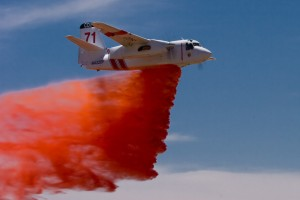 The Cal Fire Grumman S-2F3T tanker makes a retardant drop.