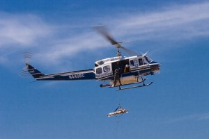 The San Diego County Sheriff's Department helicopter demonstrates search and rescue techniques.