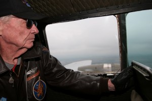 Mitch Mischler, 8th Air Force veteran and survivor of 25 missions, monitors the progress of the B-17, Aluminum Overcast.