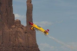 The Team Breitling plane races through the canyons in Monument Valley.