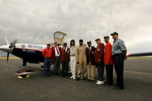 "Barrington Irving visited with Joe Jones, RMRFI art director, and members of the Tuskegee Airmen. L to R: Gilbert Wheeler, Maj. James Harrison, Col. John Mosley, Jones, Irving, Col. Fitzroy ""Buck"" Newsum, Norvell Simpson, Ron Hilliard and Willy Daniels II"