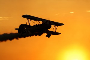 The wings of Gary Rower's Stearman glint with the setting sun.