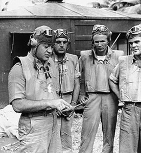 Major Pappy Boyington (far left) briefs his men before combat.