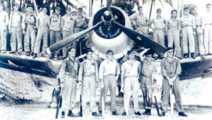 Pappy Boyington (third from right, front row) and the Black Sheep squadron are shown with Vella la Vella, a Corsair, in 1943.