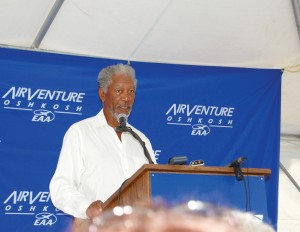 Morgan Freeman spoke with other aviation enthusiasts after a helicopter tour of the AirVenture sprawl on July 26.