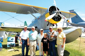 "L to R: NAHF enshrinees Joe Engle, Steve Fossett and Patty Wagstaff share a proud moment with Chuck & Bev Greenhill and their grandson Kyle. Oshkosh spectators voted the Greenhill's 1939 Grumman Duck ""Best of the Best."""