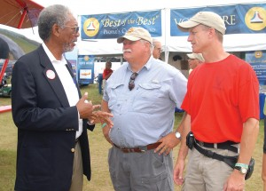L to R: Morgan Freeman, Alan Hoeweler and NAHF Executive Director Ron Kaplan visit in the NAHF/Rolls-Royce Best of the Best area. Hoeweler's 1927 Waco 10T was one of five competing aircraft.