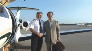 Ken Ross (left), president of North American Jet Charter Group, LLC, and captain of the world's first chartered Eclipse 500 flight, gives a firm handshake to Ben Klein, CEO of Up Stairs Solutions, who was the first paying passenger.