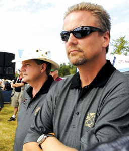 Cirrus Design Corporation cofounders Alan (left) and Dale Klapmeier take a moment to relax after the launch of the company's new SR Sport at AirVenture 2007.