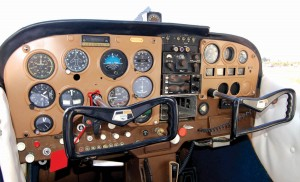 Workers mounted a new altimeter and radio in the newly painted instrument panel.