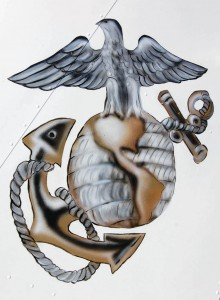 The USMC insignia is emblazoned on the Cessna's tail.