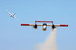 CalFire's OV-10 makes a low-level pass with smoke, to direct the incoming S-2T air tanker.