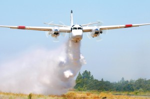 The CalFire S-2T dropped 1,000 gallons of water, as directed by the air tactical OV-10.