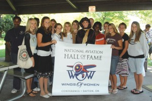 Several of the teenagers who attended the first NAHF Wings of Women Conference pose with Connie Tobias, US Airways Airbus captain. Tobias appeared at the opening breakfast in the persona of the late pioneering aviatrix, Harriet Quimby, an NAHF enshrinee.