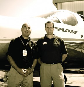 """Aviation Sales, Inc. reps Matthew Rule (left) and Jed Johnson displayed a Pilatus PC-12 distributed by their company throughout the Rocky Mountain region. Look for the """"E"""" model with new avionics in March 2008."""