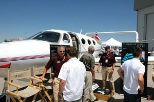Adam Aircraft reps Tom Wiesner (left) and Bob Shank (red shirt right) showed off the cabin-class pressurized Adam A500 push-pull twin. The A700 light jet, based on the same airframe, is in flight-test.