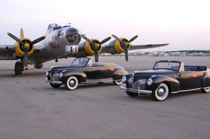The vintage B-17, Elmer Fudd, makes a great backdrop for Doc's 1941 Lincoln Zephyr (center) and a friend's 1941 Lincoln Continental.
