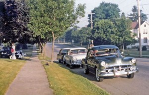 In Doc's line up for the Iola run, the Humber Super Snipe and a '55 Plymouth follow the Pontiac Eight. Around the corner is the Lincoln Zephyr convertible.