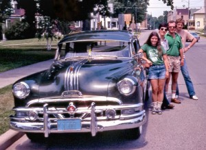 The author poses with traveling companions before setting out for Iola in the Pontiac Eight.