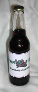 The new Vin Fiz bottle label features a female pilot believed to be Harriet Quimby.