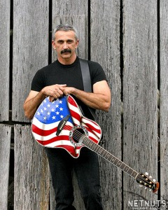"""Aaron Tippin's patriotism comes through loud and clear in his songs. """"My dad was a big patriot,"""" he said. """"When you talk about my patriotism, you're talking about that part of my dad that's in me."""""""
