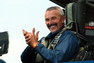 Aaron Tippin flew with the Blue Angels during AirVenture 2006. He's also participated in a USAF Thunderbirds flight; flying 9-Gs in an F-16 earned him a special 9-G pin.