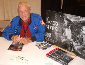 "Scott Carpenter, one of the original ""Mercury Seven"" astronauts, signed copies of his book, ""For Spacious Skies: The Uncommon Journey of a Mercury Astronaut."" Carpenter flew the second American manned orbital flight in May 1962."