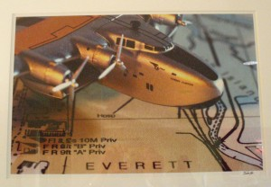 The front entrance and each room in the Navigator Inn feature this custom photo of a model aircraft over a map of Everett, Wash.