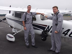 "Washington State Patrol troopers Scott Sweeney (left) and ""Kort"" Korthuis-Smith use this Cessna 206 to patrol Puget Sound freeways. A FLIR camera unit equipped with heat sensors and telephoto lenses is mounted on the side of the plane."