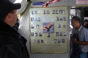 Mounted on the bulkhead just outside the cockpit is a memorial to the 31 American lives lost during the airlift. Kevin Kearney, the foundation's vice president, is shielding the bright sunlight.