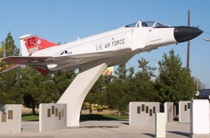 At Boeing Park in Lancaster, Calif., a full-size F-4 Phantom II jet on a pedestal soars above some of the monuments and plaques of the Aerospace Walk of Honor.