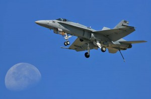 "This Navy F-18 makes a ""dirty"" flyby with wheels and hook down and flaps extended."