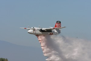 CalFire sent one of its Grumman S-2T aircraft to demonstrate a firebombing run.