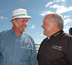 GlobalFlyer designer Burt Rutan (left) and pilot Steve Fossett visit before a media briefing at EAA AirVenture Oshkosh 2005.