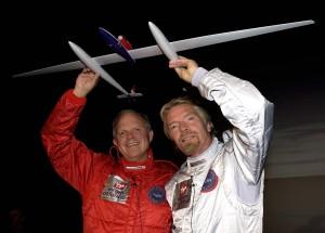 GlobalFlyer sponsor Sir Richard Branson (right) helps Steve Fossett display a model of the record-breaking aircraft.