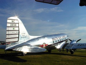 The DC-3 first flew in 1935 and became the standard for air travel until the 1950s. Some were still in passenger service through 1985. The aircraft held up to 28 passengers and had many safety features.