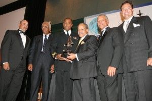 L to R: Capt. Daniels, Col. Bluford, Ed Dwight Jr., Maj. Gen. Charles F. Bolden and Dave Aguilera present the Ed Dwight Jr. Award to Lt. Victor Glover (third from left).