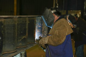 "Welders attach the ""wavy-web"" to the bottom flange. Every EagleSpan truss is custom made for each installation."