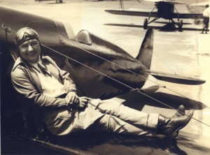 Pancho Barnes rests on the wing of her Travel Air Model R, which she later loaned to stunt pilot Paul Mantz for use in the movies.
