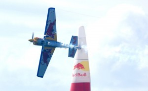 American pilot Kirby Chambliss, of Team Red Bull, demonstrates knife-edge flying past an air gate on the San Diego racecourse.